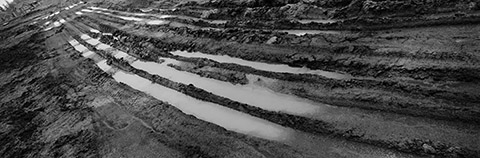 """Markham, Ontario   43°54'28.78""""N  79°14'59.11""""W, facing South-Southeast, circa May 21, 2004  Tracks of heavy equipment carved into the muddy subsoil on the former James and Adam Clendenen family farms, during its development into a suburban subdivision of roughly 2,500 homes."""